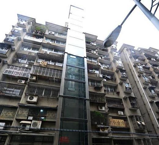 ...阳首例居民集资旧楼加装电梯运行图片 54856 520x473