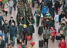 1月24日,北京西客站,武警执勤官兵下哨归来。