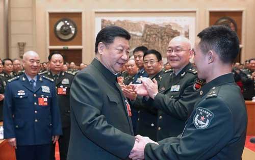 中共中央总书记、国家主席、中央军委主席习近平出席十三届全国人大一次会议解放军和武警部队代表团全体会议。